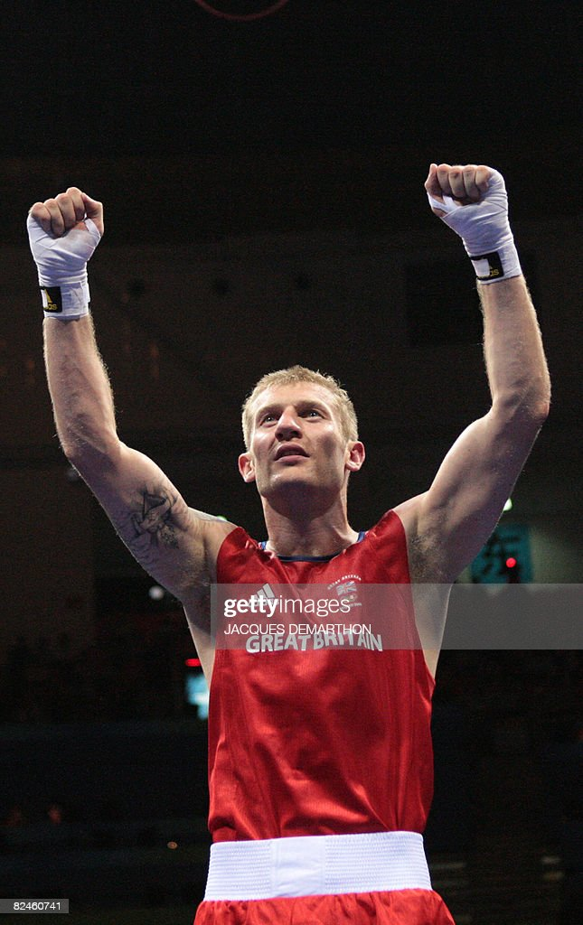 Great Britain's Tony Jeffries celebrates his victory over Hungary's Imre Szello during their 2008 Olympic Games Light Heavyweight quarterfinals...
