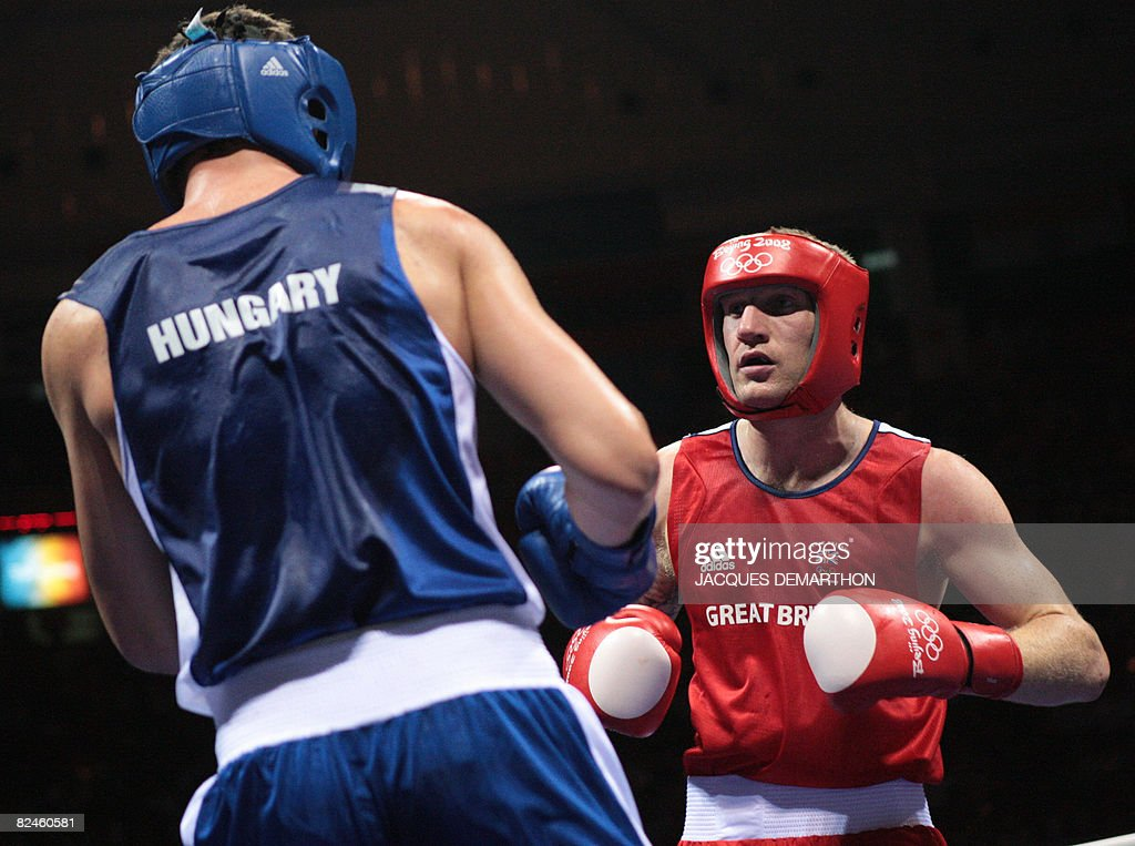 Great Britain's Tony Jeffries fights against Hungary's Imre Szello during their 2008 Olympic Games Light Heavyweight quarterfinals boxing bout on...