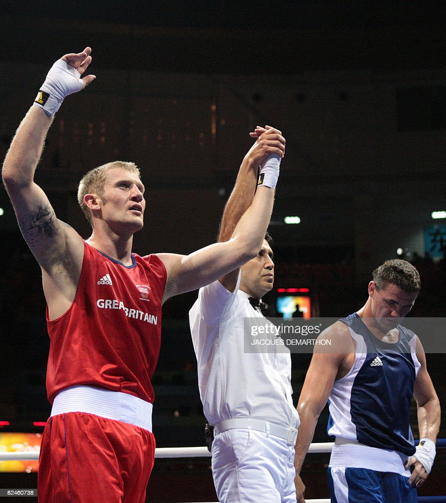 Great Britain's Tony Jeffries is declared winner after defeating Hungary's Imre Szello during their 2008 Olympic Games Light Heavyweight...