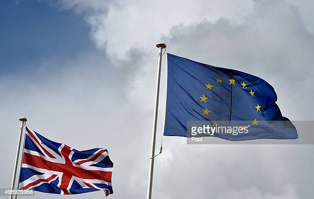 Great Britain's Union Jack flag flutters next to the EU flag at the opening ceremony of the Commonwealth Heads of Government Meeting at the...