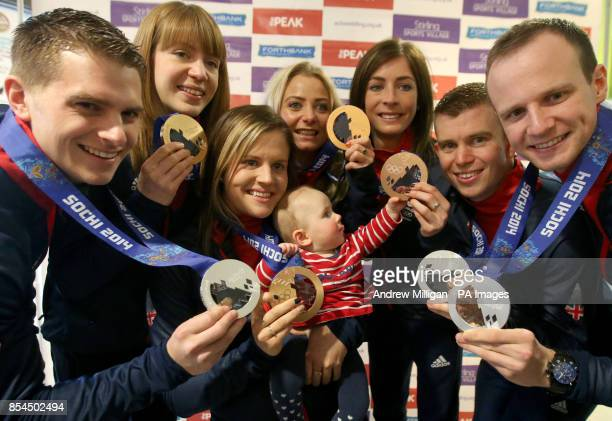 Great Britain's Vicki Adams holds baby Flora Rennie from Dunblane during a photocall with men and womans teammates on their return to The Peak at...