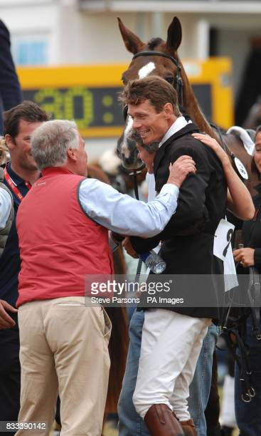 Great Britain's William FoxPitt is congratulated after winning the Land Rover Burghley Horse trials at Burghley House in Stamford Lincs by British...
