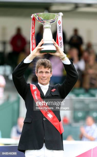 Great Britain's William FoxPitt wins the HSBC Classics Competition and is presented with the trophy on the show jumping day during the Burghley Horse...