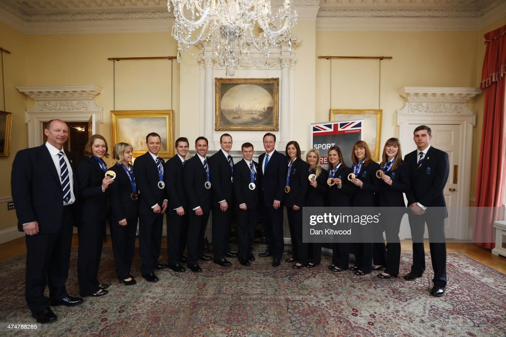 Great Britains Winter Olympic Medalists pose with their medals with Britain's Prime Minister David Cameron at 10 Downing Street on February 25 2014...