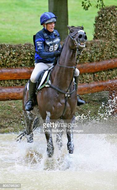 Great Britains Zara Phillips and Glenbuck ride through the Trout Hatchery as they compete in the Cross Country during day three of the Burghley Horse...