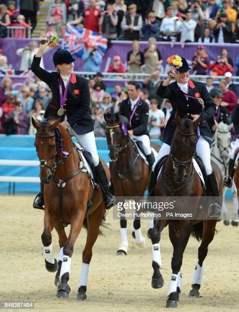 Great Britain's Zara Phillips and Kristina Cook celebrate with their silver medals during the Team Eventing Medal ceremony on day four of the London...