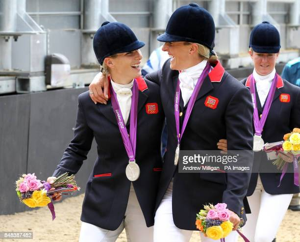 Great Britain's Zara Phillips and Tina Cook celebrate with their silver medals following the Team Eventing Medal ceremony on day four of the London...
