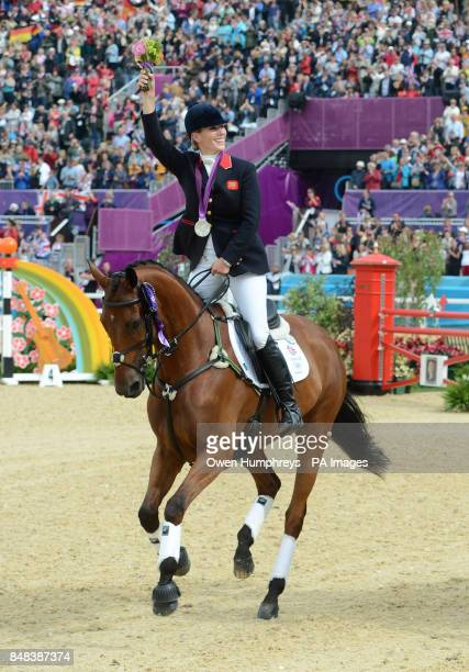 Great Britain's Zara Phillips celebrates with her Silver medal during the Team Eventing Medal ceremony on day four of the London Olympic Games at...