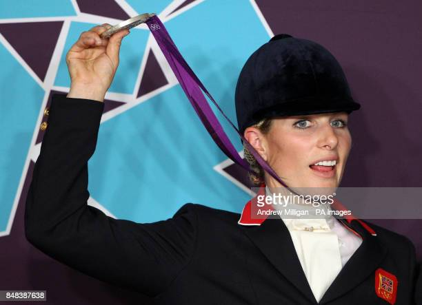 Great Britain's Zara Phillips holds her silver medal after finishing second in the Team Eventing on day four of the London Olympic Games at Greenwich...