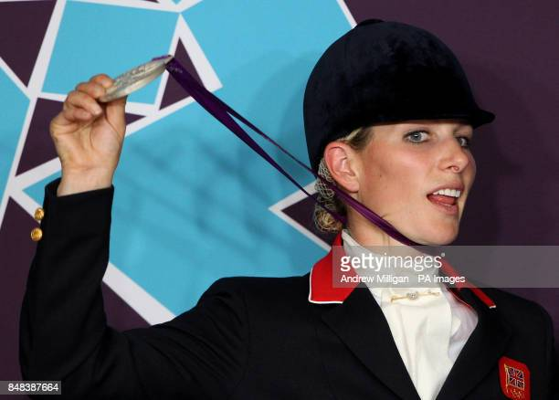 Great Britain's Zara Phillips holds her silver medal during a press conference after finishing second in the Team Eventing on day four of the London...