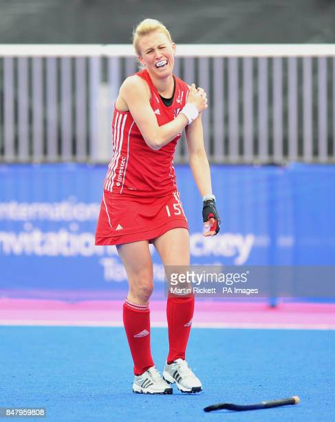 Great Britian's Alex Danson holds her shoulder as she leaves the field during the Gold Medal Hockey match against Argentina during the Visa...