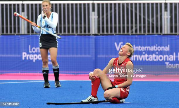 Great Britian's Alex Danson in tears after an injury forces her to leave the pitch during the Gold Medal Hockey match against Argentina during the...