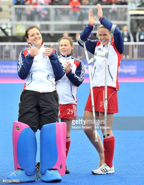 Great Britian's Crista Cullen celebrates with Beth Storry and Sarah Thomas after winning the Gold Medal match against Argentina during the Visa...