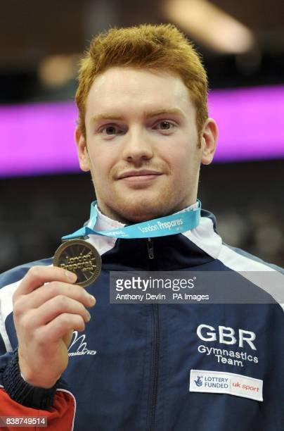 Great Britian's Danbiel Purvis poses with his Gold medal following the Men's Individual final during the Visa International Gymnastics at the North...