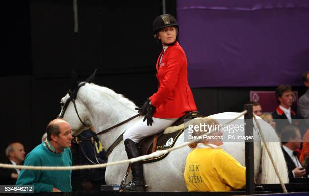 Great Britian's Ellen Whitaker riding Ladina B watches with her dad Steven after knocking a brick out of the wall in the Puissance on day four of the...