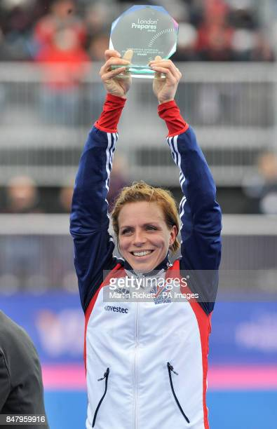 Great Britian's Women's Hockey captain Kate Walsh hold's the trophy after winning the gold medal match against Argentina during the Visa...