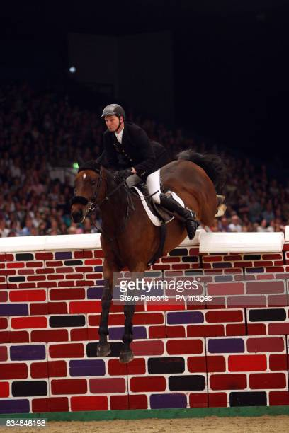 Great Britian'sDerek Morton Teddy Bear II competes in the Puissance on day four of the Horse of the Year show at the NEC arena in Birmingham