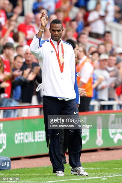 Great British Olympic athlete Germaine Mason presents his silver medal to the crowd prior to kick off