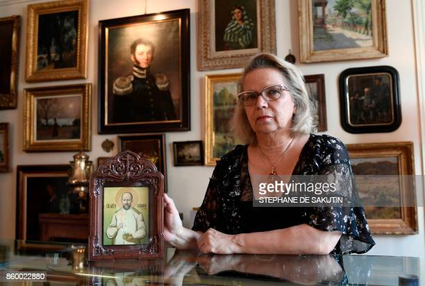 Great granddaughter of Tsar Nicolas II family's last doctor Eugene Botkin Catherine Melnik Duhamel poses with an icon depicting her great grandfather...