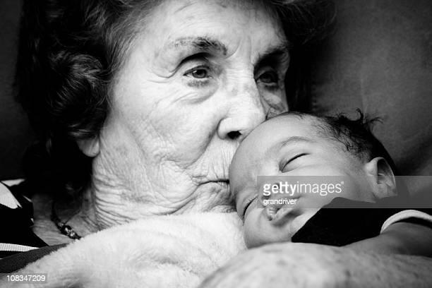 Great Grandma holding a Baby Boy
