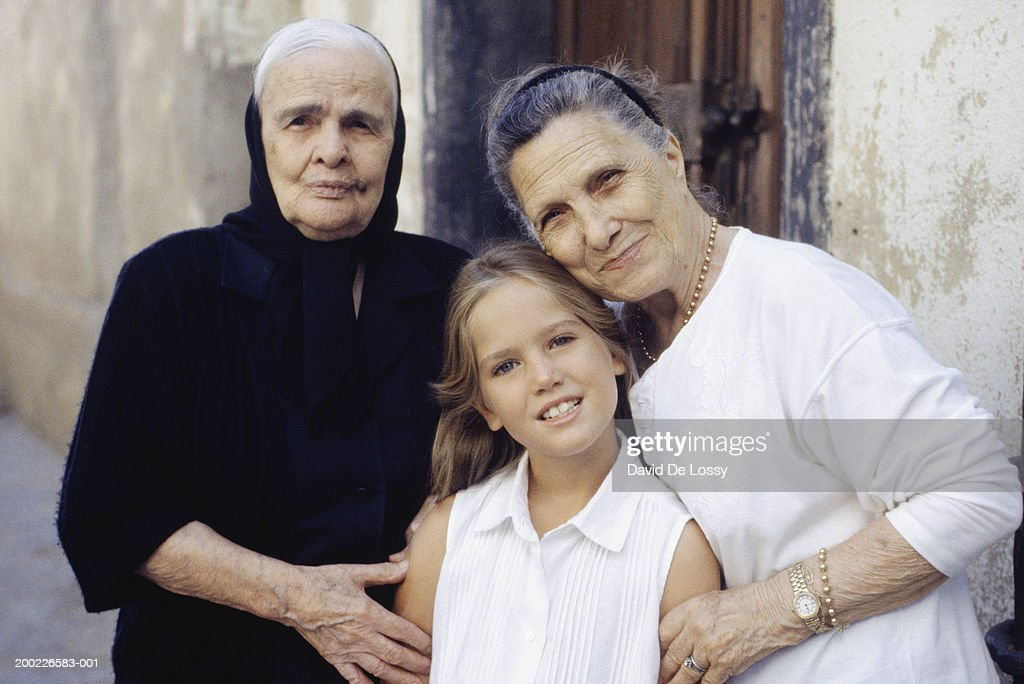 Great grandmother and grandmother embracing young girl (8-9), waist up, portrait : Stock Photo