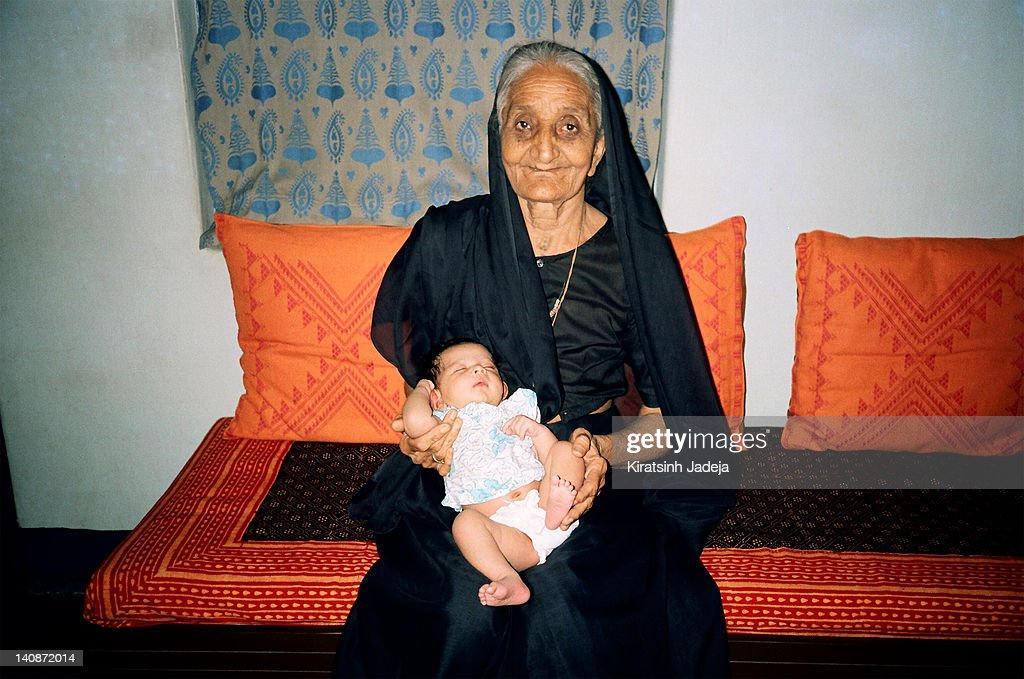 Great Grandmother Holding Her Great Grandson : Stock Photo