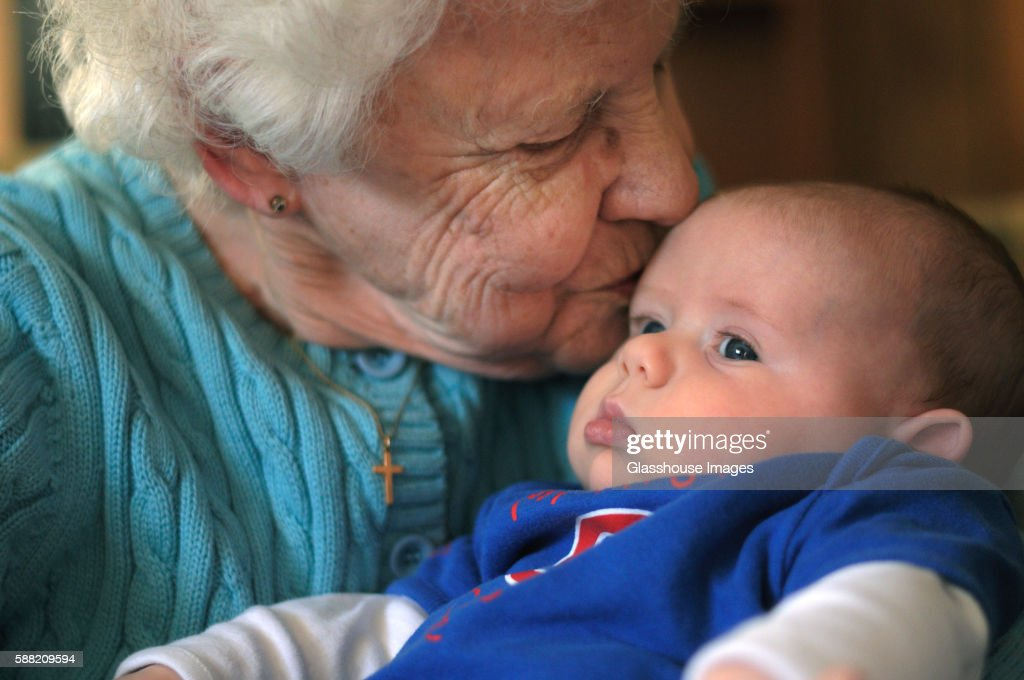 Great Grandmother Kissing Great Grandson