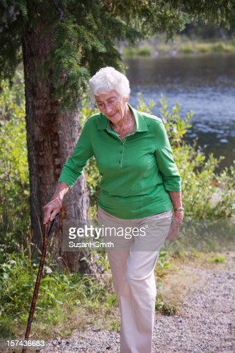 A great grandmother on a walk by a river