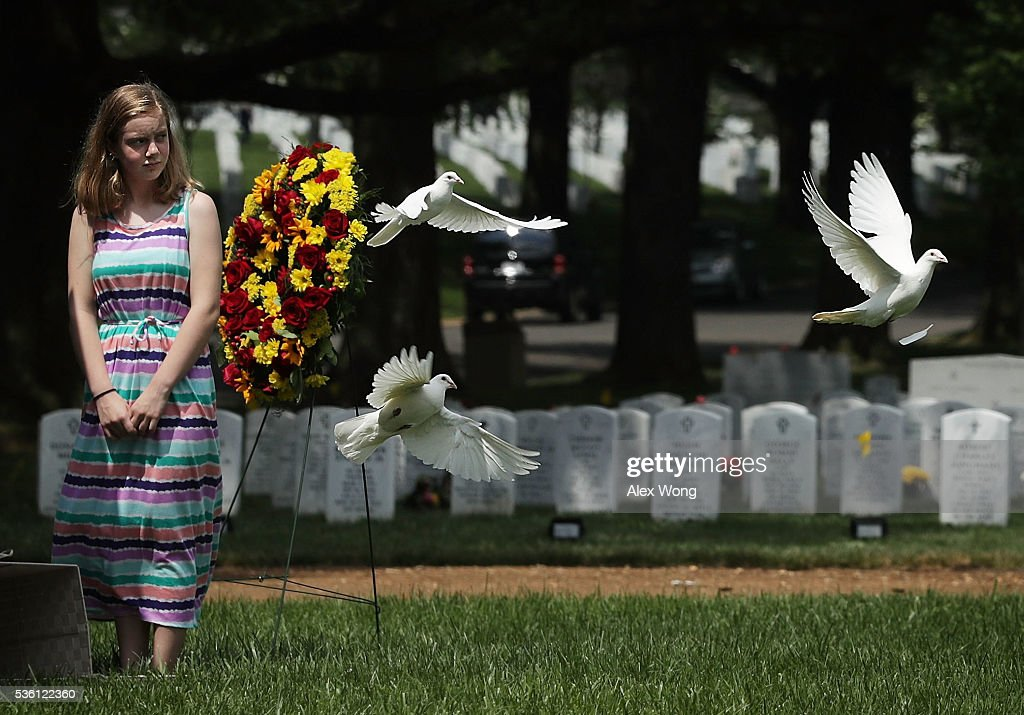 Great grandniece Madeline Brumbaugh of Springfield, Virginia, watches doves flying away as the birds are being released during the burial of Private First Class James Bernard Johnson May 31, 2016 at Arlington National Cemetery in Arlington, Virginia. Johnson was assigned to Company K, 3rd Battalion, 8th Marines, 2nd Marine Division during WWII. He died sometime on the first day of battle against the Japanese, November 20, 1943, in an attempt to secure the small island of Betio in the Tarawa Atoll of the Gilbert Islands after landing.