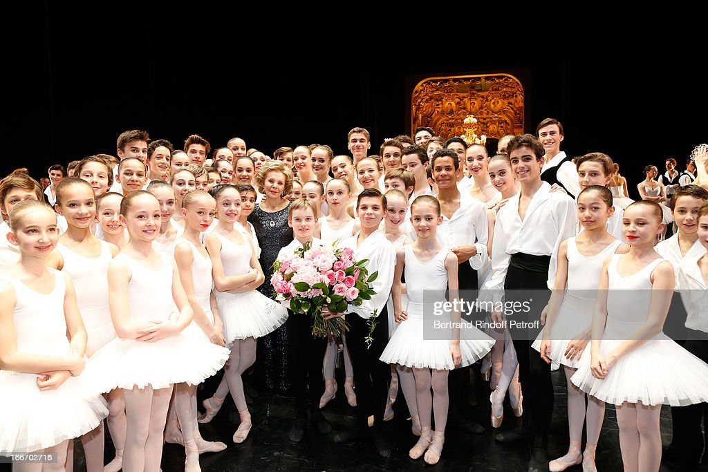 Great Mecene of French school of dance Lily Safra between Students of the Dance School of Opera de Paris on stage while Tricentenary of the French dance school, AROP Gala, at Opera Garnier on April 15, 2013 in Paris, France.