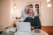 Senior couple looking at a laptop computer