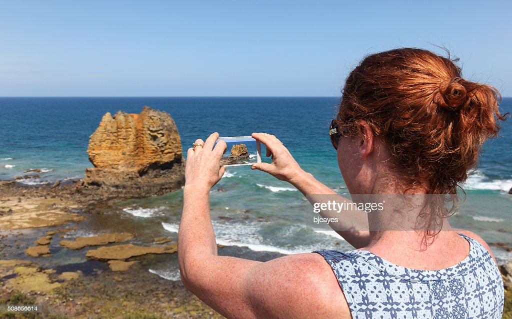 Great Ocean Road Tourist Taking Phone Photo : Stock Photo