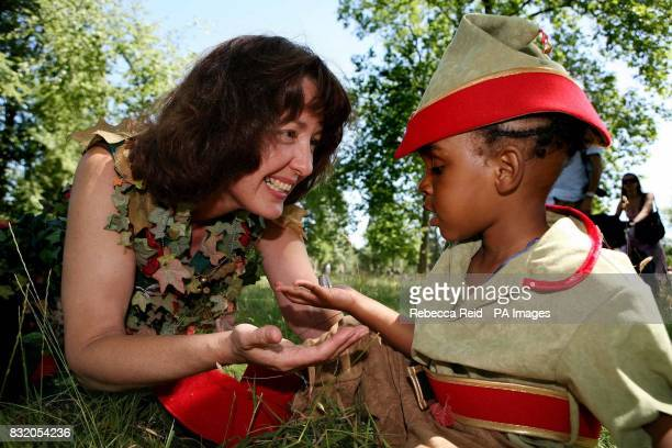Great Ormond Street Hospital patient Simeon LynchPrime aged five presents children's writer Geraldine McCaughrean left with a thimble kiss during a...