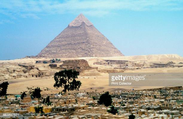 Great Pyramid of Cheops at Giza Egypt 4th dynasty Old Kingdom 26th century BC View of the pyramid overlooking a Muslim cemetery The Great Pyramid is...