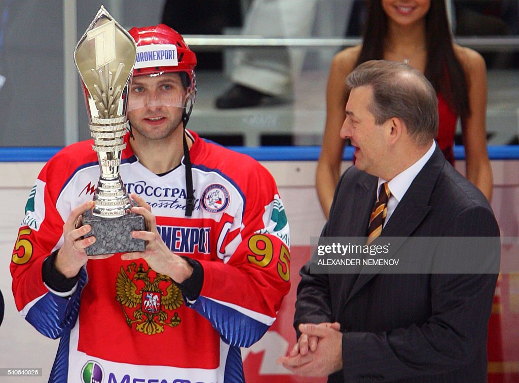 Great Soviet goalkeeper Vladislav Tretiak looks at Russian team's captain Alexey Morozov holding a trophy after defeating team Sweden 62 during...