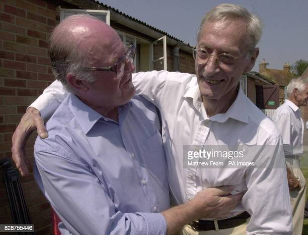 Great Train Robber Bruce Reynolds meets former police officer John Woolley at Oakley Village Hall Buckinghamshire during a village fete Mr Woolley...