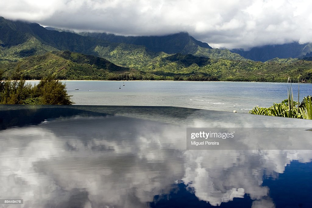 A great white cloud reflected on a pond at the hotel Princeville Resort in Kauai