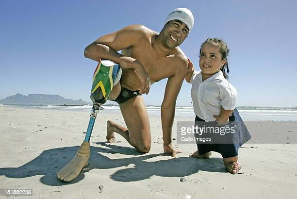 Great White shark attack survivor Achmat Hassiem poses on the beach with Alex Pasuali on February 01 2008 in Cape Town South Africa