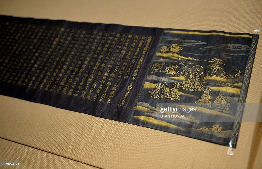 'Great Wisdom Sutra from the Chusonji Temple Sutra Collection (Chusonjikyo), Heian period, ca. 1175, a handscroll, gold and silver on indigo-dyed paper, on display in the exhibition 'Brush Writing in the Arts of Japan' August 19, 2013 at The Metropolitan Museum of Art in New York. AFP PHOTO/Stan HONDA