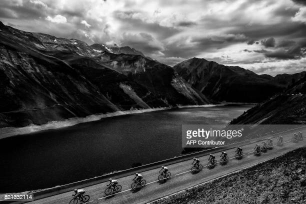 GreatBLACK Britain's Christopher Froome wearing the overall leader's yellow jersey rides in the pack past a lake during the 183 km seventeenth stage...