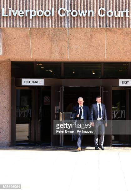 Greater Manchester Police chief constable Sir Peter Fahy leaves Liverpool Crown Court Liverpool where he appeared charged with failing to discharge a...