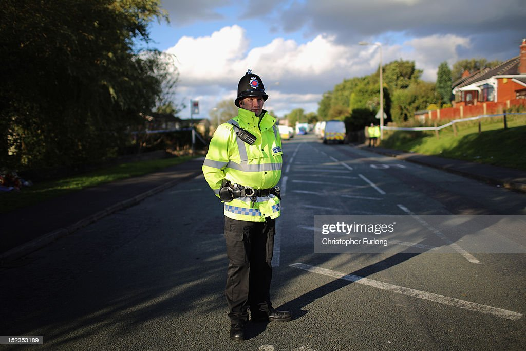 A Greater Manchester Police officer continues to guard the scene of the shooting of WPC's Nicola Hughes and Fiona Bone in Hattersley on September 19, 2012 in Manchester, England. Local man Dale Cregan, 29, has been arrested in connection with the shooting of WPC's Nicola Hughes and Fiona Bone, who were killed as they responded to a routine incident at Abbey Gardens in Hattersley shortly before 11am yesterday.