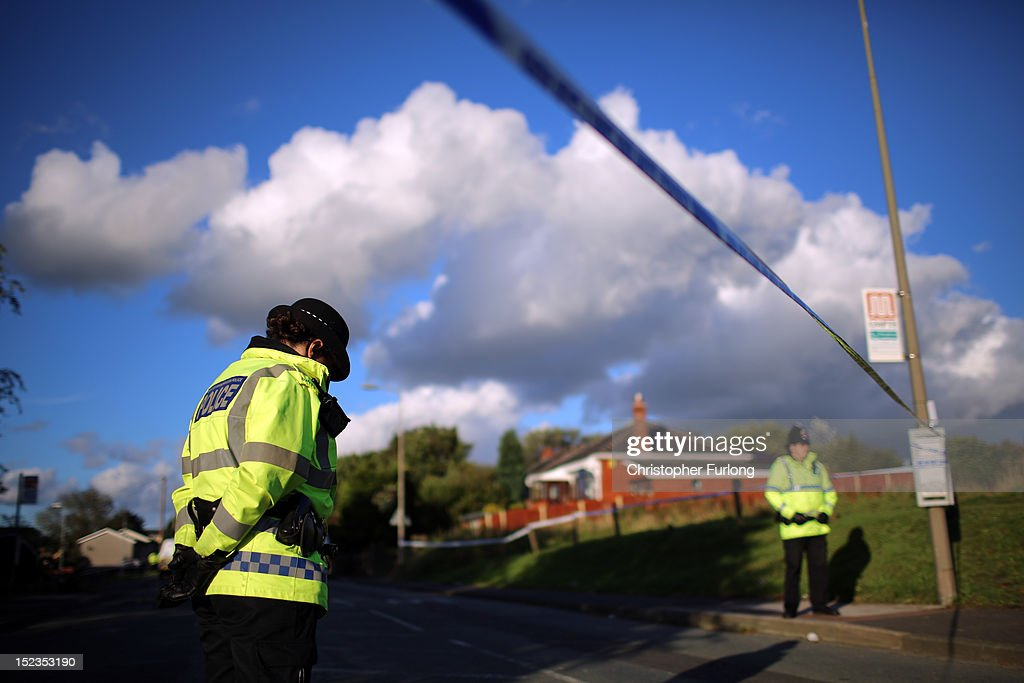 Greater Manchester Police officers continues to guard the scene of the shooting of WPC's Nicola Hughes and Fiona Bone in Hattersley on September 19, 2012 in Manchester, England. Local man Dale Cregan, 29, has been arrested in connection with the shooting of WPC's Nicola Hughes and Fiona Bone, who were killed as they responded to a routine incident at Abbey Gardens in Hattersley shortly before 11am yesterday.