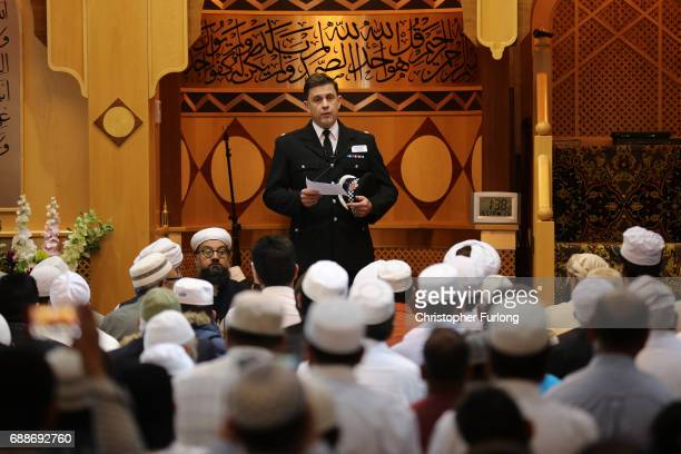 Greater Manchester Police Superintendent David Pester gives an address to worshipers at Friday prayers at Manchester Central Park Mosque on May 26...