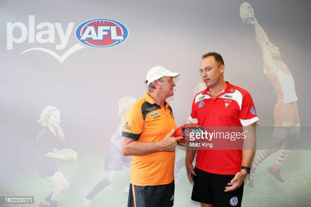 Greater Western Sydney coach Kevin Sheedy and Sydney Swans coach John Longmire talk ahead of their NAB Cup match at Moore Park on February 21 2013 in...