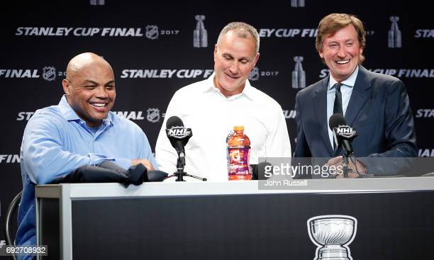 NHL greats Wayne Gretzky and Paul Coffey welcomes former NBA player Charles Barkley as they announce the greatest NHL team during a press conference...