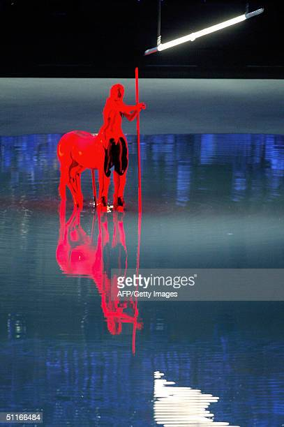 A centaur stands in a pool of water in he Olympic Stadium in Athens during the opening ceremony of the 2004 summer games Some 10000 athletes...