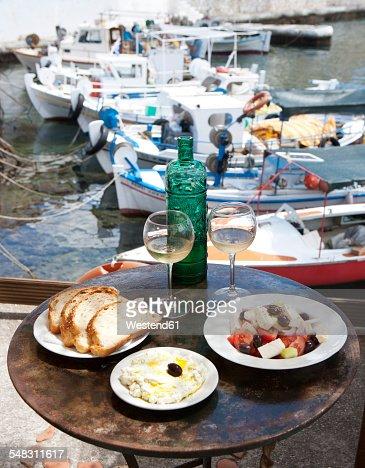 Greece, Agios Nikolaos, traditional Greek starters and wine on table