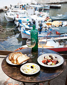 Greece, Agios Nikolaos, traditional Greek starters and wine on table