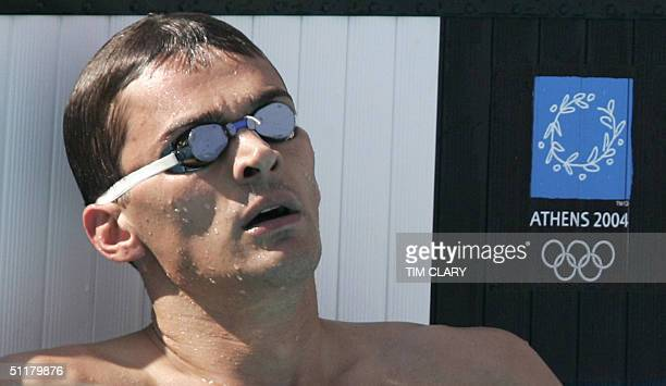 Alexander Popov from Russia reacts at the end of the men's 100m freestyle heat 9 at the 2004 Olympic Games at the Olympic Aquatic Center in Athens 17...